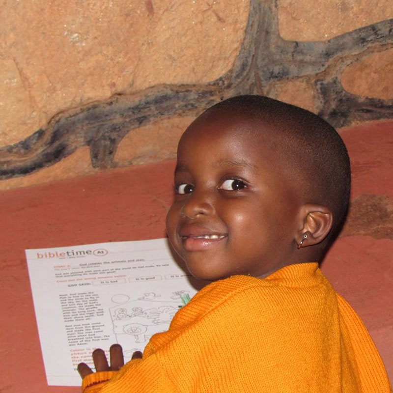 ugandan-child-doing-bibletime